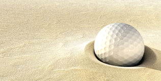 Golf Ball in Sand Trap hazzard. Golf ball sitting deep in a sand trap hazzard Royalty Free Stock Images