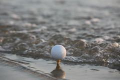 Golf ball in the sea Royalty Free Stock Photography