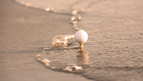 Golf ball in the sea Stock Image