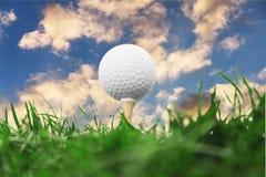 Golf ball on sky background stock photo