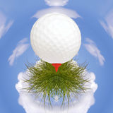 Golf ball on small planet Stock Photo