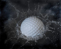 Golf ball splash Royalty Free Stock Photography