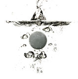 Golf Ball Splashing in Water Royalty Free Stock Image