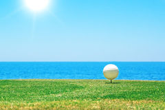 Golf ball on a stand. Royalty Free Stock Photos