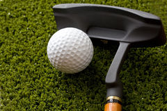 Golf ball and stick Stock Photos