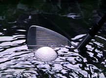 Golf ball in a stream Royalty Free Stock Photo