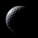 Golf Ball. Stylish Golf Ball on a Black Background royalty free stock photo