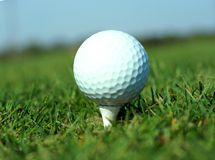 Golf ball in tall green grass set against blue sky Royalty Free Stock Photos