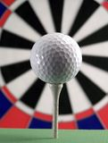 Golf ball on target. Golf ball on tee with a target background Royalty Free Stock Photos