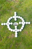 Golf ball target around hole Stock Images