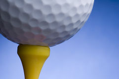 Golf ball and tee. Isolated golf ball and tee close up royalty free stock images