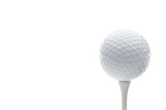 A golf ball on a tee Stock Photos