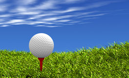 Golf ball on tee. Golf ball on red tee, with grass and sky background Stock Photo