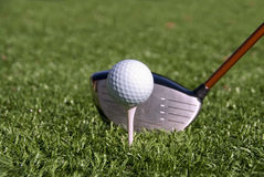 Golf Ball on Tee. A white golf ball on a tee ready to be hit by a driver royalty free stock photo