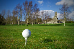 Golf ball on the tee. Idyllic golf course of irish Adare Royalty Free Stock Photo
