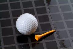 Golf ball and tee Stock Photos