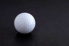 Golf ball and tee Stock Image