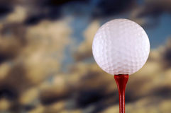 Golf Ball On Tee. Ball on Tee against sky royalty free stock photos
