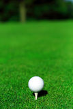 Golf ball and tee. A set of golf ball and tee on grass Royalty Free Stock Photos