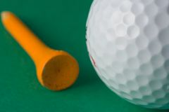 Golf Ball and Tee. Close-up of a golf ball and tee (shallow dof Royalty Free Stock Image