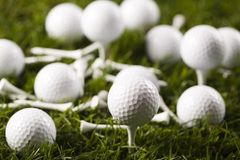 Golf ball on tee. In grass Stock Photography