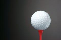Golf ball on tee. Royalty Free Stock Photo