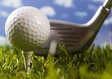 Golf ball on tee with club Royalty Free Stock Photos
