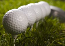 Golf ball on tee with club Stock Photo