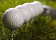 Golf ball on tee with club Stock Photo