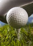 Golf ball on tee with club Royalty Free Stock Image