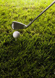 Golf ball on tee with club Stock Photos