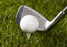 Golf ball on tee with club Stock Images