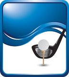 Golf ball on tee with club on blue background Royalty Free Stock Image
