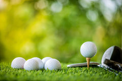 Golf ball on tee. With golf club ready to practice Royalty Free Stock Images