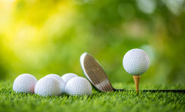 Golf ball on tee. With golf club ready to practice Stock Photo