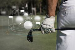 Golf ball with tee on course and stick Royalty Free Stock Photo