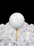 Golf ball on tee in diamonds. Ultimate golf sparkling ball on tee amongst diamonds stock photos
