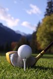 Golf ball on tee with driver and autumn colours Stock Photo