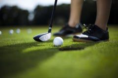Golf ball on tee Stock Photos