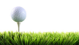 Golf ball with tee in the grass. On white Royalty Free Stock Images