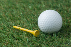 Golf ball with tee Stock Photography