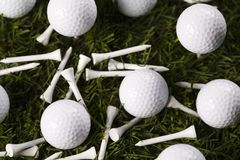Golf ball on tee in grass Royalty Free Stock Image
