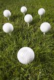 Golf ball on tee in grass.  Stock Images