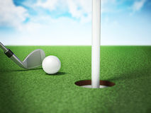 Golf ball and tee on the grass court Stock Image