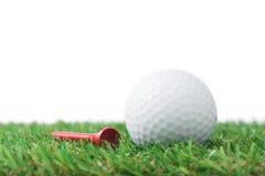 Golf ball with tee Stock Photos