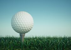 Golf ball with tee in the grass Royalty Free Stock Image