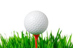 Golf ball on tee isolated Royalty Free Stock Photo