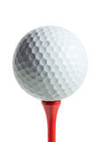 Golf ball on a tee. Isolated on white background Stock Image