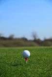 Golf ball tee off Stock Images