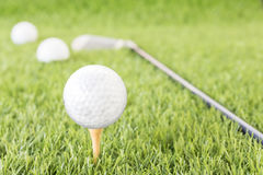 Golf ball on tee Stock Images